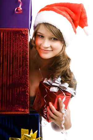 Portrait of beautiful girl holding present behind pile of boxes Stock Photo - 3715881