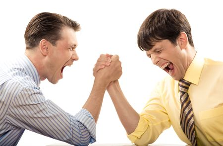 strong arm: Portrait of emotional men screaming during arm wrestling competition