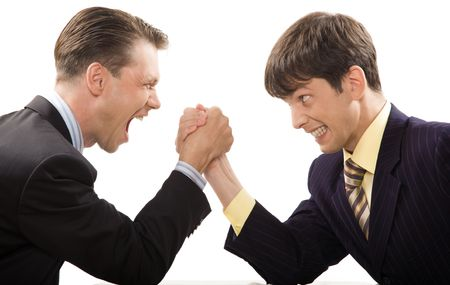 cope: Image of tense businessmen trying to cope with each other in struggle Stock Photo