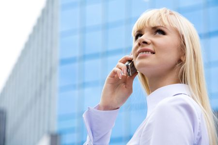 Image of confident business lady talking on cell in the city and looking upwards Stock Photo - 3715776
