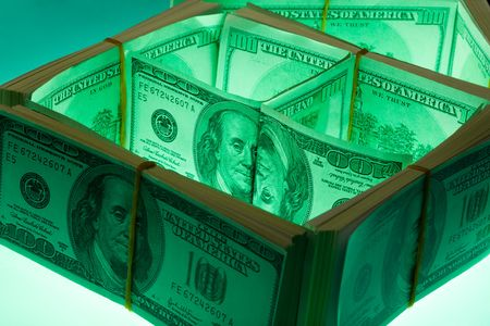 Close-up of house made of dollars with green highlight Stock Photo - 3712053