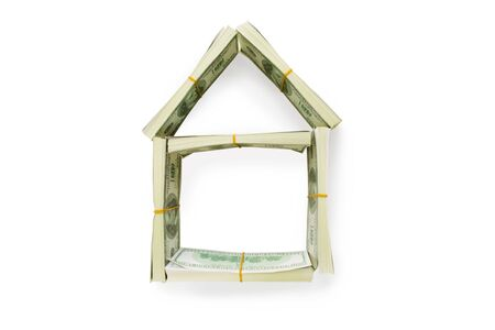 Form of house made of American dollars over white background photo