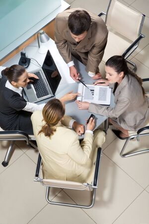discussion group: Portrait of businesspeople interacting and brainstorming together at meeting  Stock Photo