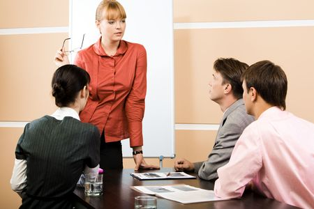topic: Image of smart teacher explaining new topic to students at lecture Stock Photo
