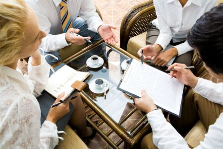 Close-up of businesspeople discussing a plan at meeting  photo
