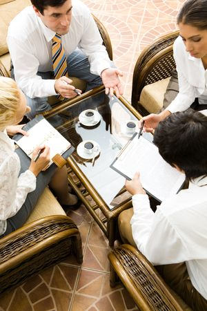 Vertical image of people interacting together at meeting  photo