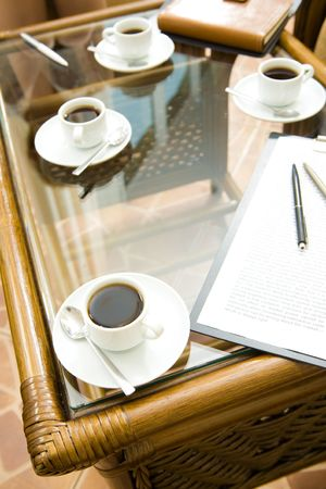 Image of paper, cups of coffee, pens and notepad placed on the table Stock Photo - 3717259