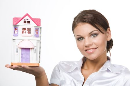 Portrait of young woman holding toy house on a white background  Stock Photo - 3716805