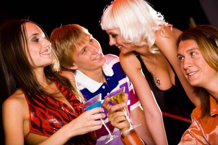 Portrait of four attractive people interacting in the nightclub Stock Photo - 3716867