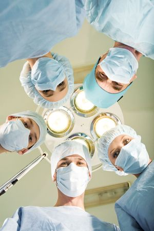 Team of medical staff looking at camera in hospital Stock Photo - 3716836