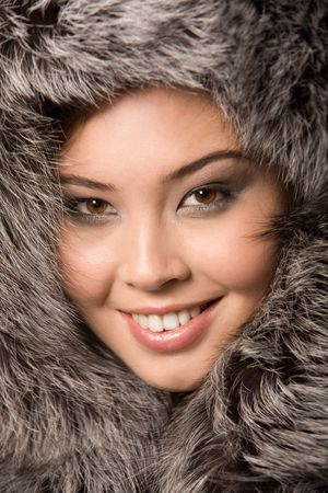 Close-up of young beautiful girl wearing fur-cap and smiling Stock Photo - 3725077