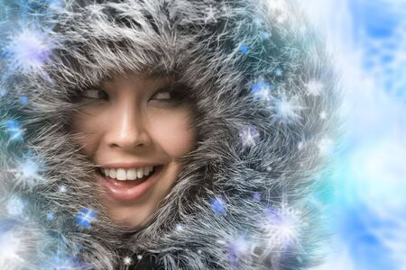 Creative photo of laughing woman framed by snowflakes Stock Photo - 3725074