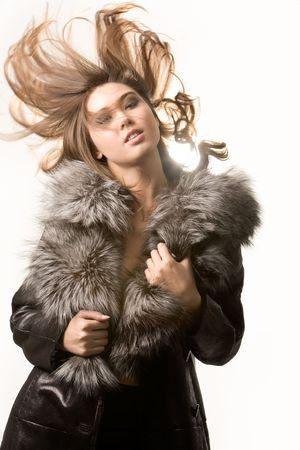Portrait of very beautiful woman wearing fashionable winter overcoat posing before camera photo