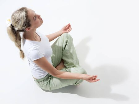Above view of fit woman sitting and meditating Stock Photo - 3730275