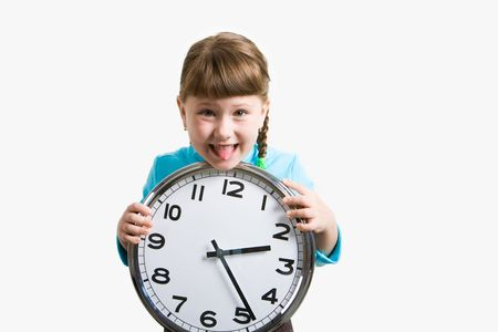 Photo of funny girl showing her tongue and holding clock in hands photo