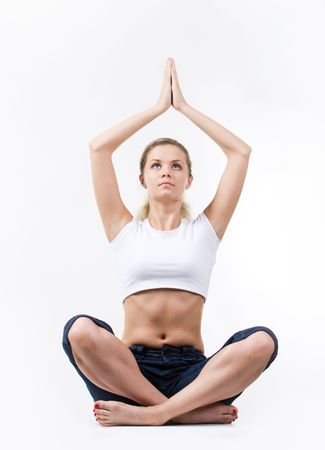 kept: Photo of meditating woman sitting with her arms raised and kept in touch Stock Photo