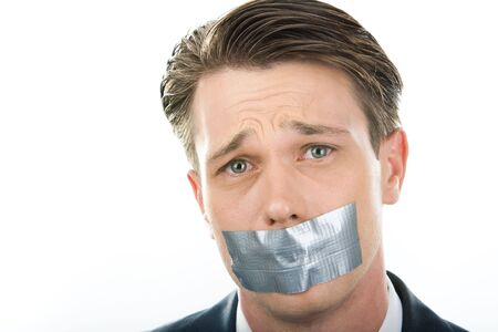 Face of unhappy man having his mouth closed with sellotape photo