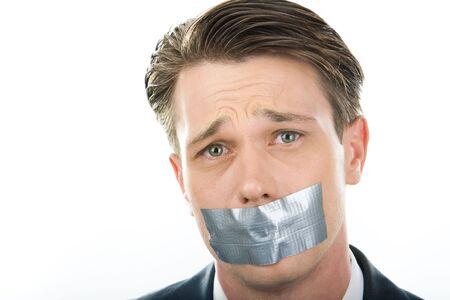 mouth closed: Rostro de hombre infeliz tener la boca cerrada con sellotape