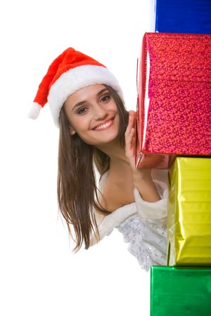heap snow: Portrait of attractive snow girl standing by heap of christmas presents Stock Photo