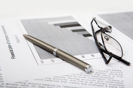 Close-up of business objects: documents, pen, glasses photo