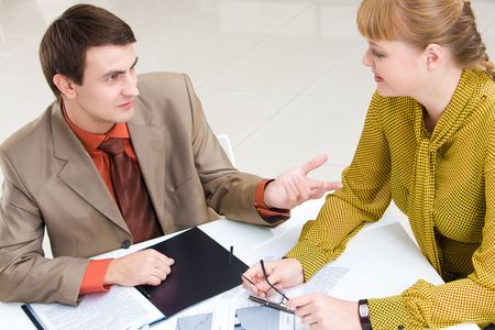 Businesswoman and businessman discuss a plan at meeting  photo