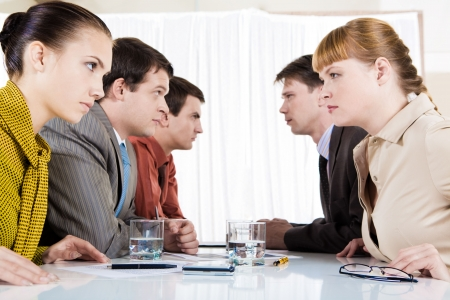 Image of business conflict between partners sitting opposite each other Stock Photo