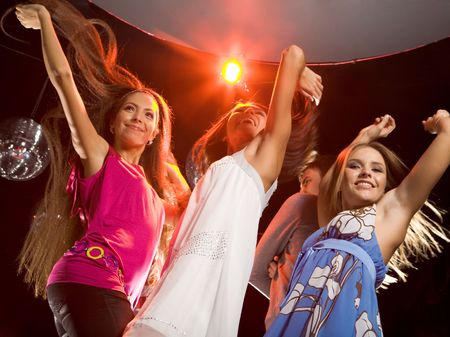 Image of happy teenagers raising their arms while dancing at disco Stock Photo - 3787752