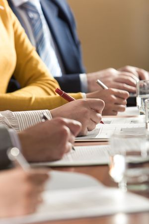 executive courses: Image of row of people hands over papers at workplace Stock Photo