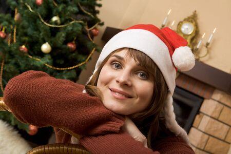 Portrait of smiling woman wearing santa cap looking at camera Stock Photo - 3850992