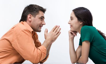 Happy couple having conversation face to face and looking at each other photo