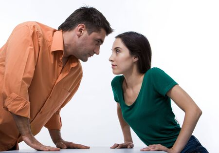 opposite: Man and woman looking at each other with displeasure on white background