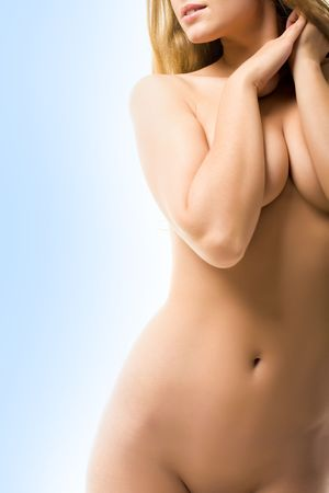 naked female: Torso of naked female keeping her arms on breasts over blue background