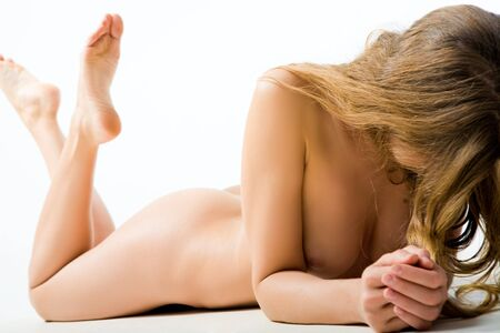 Photo of charming woman lying naked over white background Stock Photo - 3850956