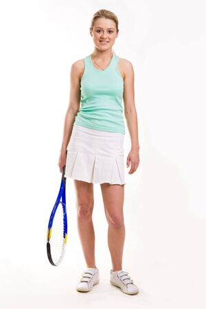 Portrait of sporty girl with tennis rocket standing on white background photo