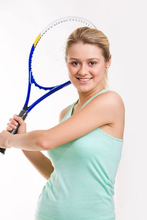 Portrait of pretty girl with tennis racquet ready to receive ball photo