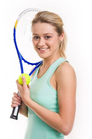 Portrait of happy tennis player with racket and ball in hands looking at camera photo