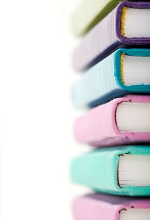 hard bound: Stack of various colors books with focus on their fore part Stock Photo