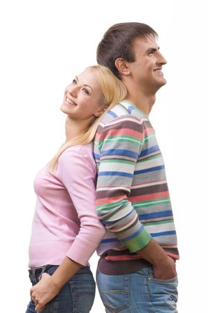 stylish couple: Happy lad and his girlfriend standing back to back and laughing