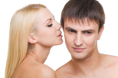 provocative couple: Luxurious woman whispering something to her sweetheart on white background