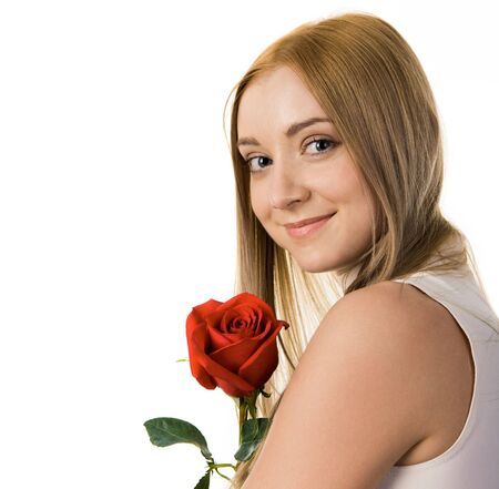Smiling lady with red rose looking at camera over white background photo