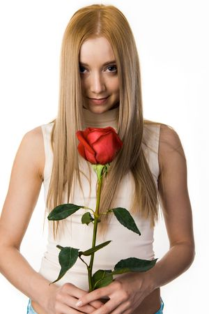 Portrait of elegant long-haired lady with beautiful rose looking at camera photo