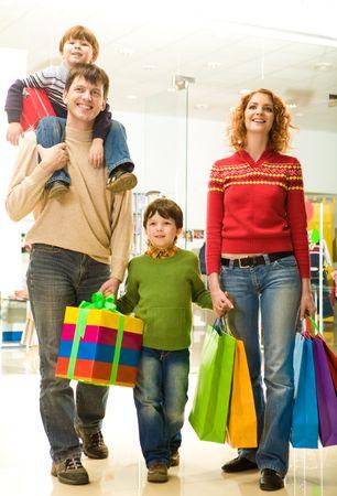 go shopping: Modern family going shopping in trade center before Christmas time Stock Photo