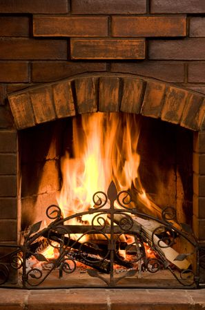 Close-up of bright and hot fire burning in chimney on Christmas eve photo