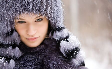 Portrait of charming girl wearing fur outer clothing somewhere outdoors Stock Photo - 3929295