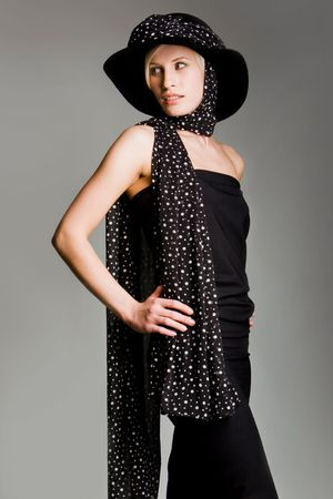 Portrait of elegantly dressed female in retro black evening gown and scarfed head with hat on it Stock Photo - 3929189
