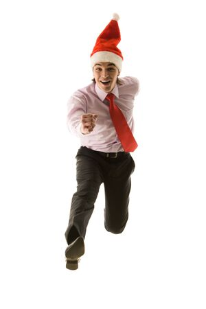 Portrait of running businessman in santa cap over white background photo