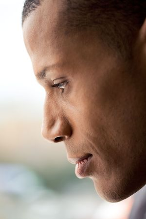 Profile of man�s face with calm expression on it over blurry background Stock Photo - 3929200