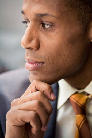 Thinking specialist touching his chin and looking aside Stock Photo - 3929260
