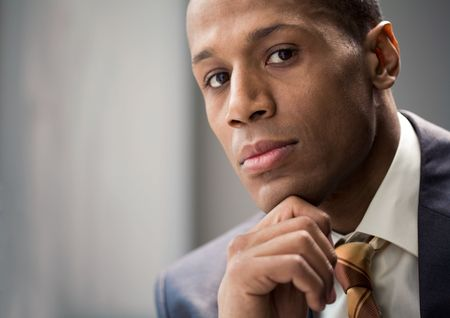 Portrait of confident entrepreneur keeping his hand on chin and looking at camera Stock Photo - 3929192