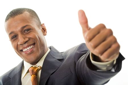 job satisfaction: Happy businessman showing his thumb up with smile over white background